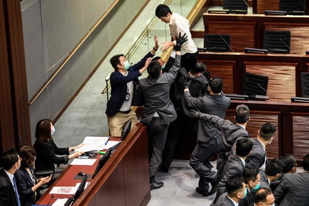 Hong Kong activists charged as clashes erupt in legislature