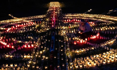 Nightly blaze of candles lit in homage to German virus victims