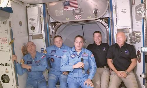 SpaceX capsule with two astronauts docks with ISS