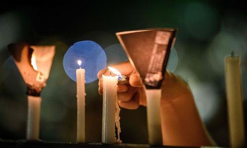Hong Kong defies ban to hold Tiananmen vigil