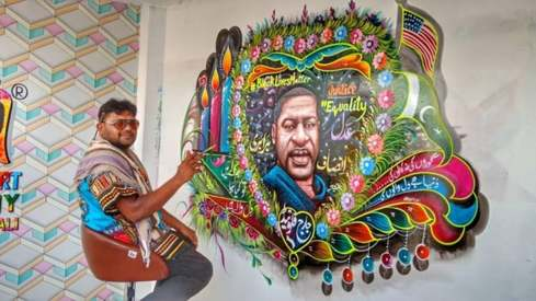 A Pakistani truck artist painted a mural in his home in memory of George Floyd