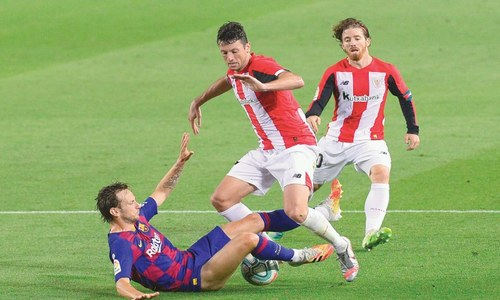 Barca grind out Bilbao win to put pressure back on Real