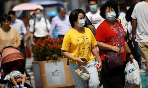 Beijing says residents can go mask-free as China Covid cases hit new lows