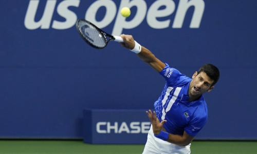 Djokovic reaches last 16 as bizarre delay shrouds US Open