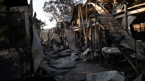 Greece accuses migrants of deliberately burning their camp