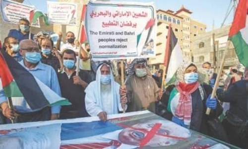 Palestinians take to streets against deals