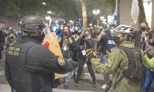 Police clash with anti-racism protesters and press in Portland