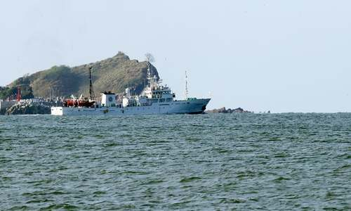North Korea warns South's navy over search for dead official