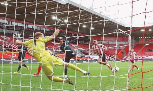 Handball row as Newcastle earn late point at Spurs
