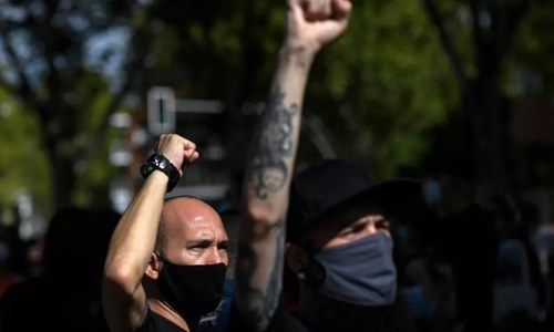 Protests in Madrid before widening of partial lockdown