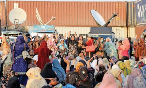 Lady health workers continue sit-in at the edge of Red Zone