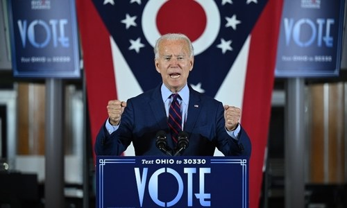 Pandemic politics: Biden shuns 'false promises' of fast fix