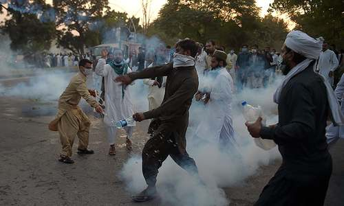 Islamabad police fire tear gas as protesters breach blockades outside Red Zone