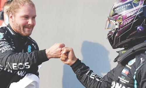 Bottas upstages Hamilton to take pole