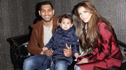 Amir Khan and family escape injury after car crashes into a barrier on UK motorway