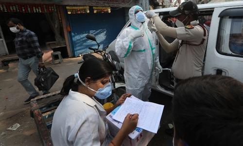 Delhi quadruples mask fines as virus cases soar