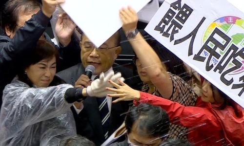 Lawmakers throw pig guts, punches on Taiwan parliament floor over pork import policy