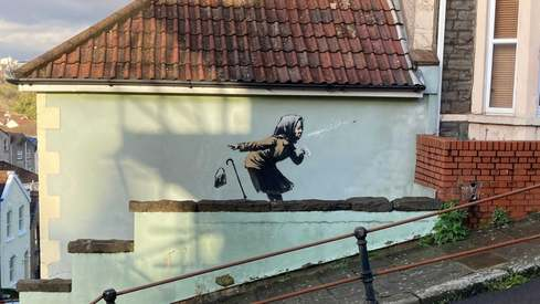 UK homeowner delays sale of home after Banksy mural appears on wall
