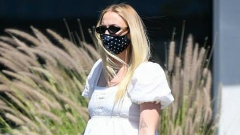 If Sophie Turner can wear a facemask while giving birth, you can wear one outside your home