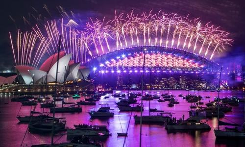 In pictures: Fireworks explode over empty streets as 2020 slinks away into history