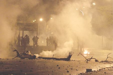 Riots break out in Tunisia as economy takes a hit