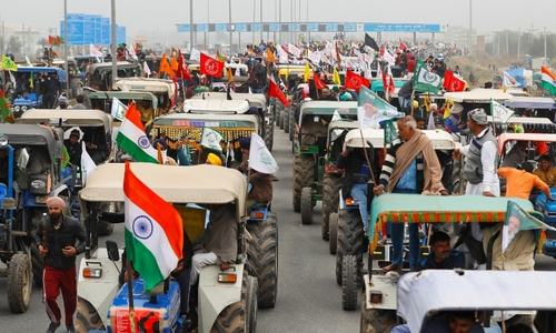 Indian farmers ride caravan of tractors into capital ahead of Republic Day