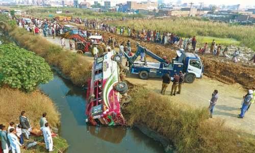 Three killed as bus falls into drain