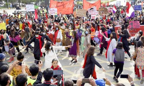 Women's day rallies held amid strict govt guidelines