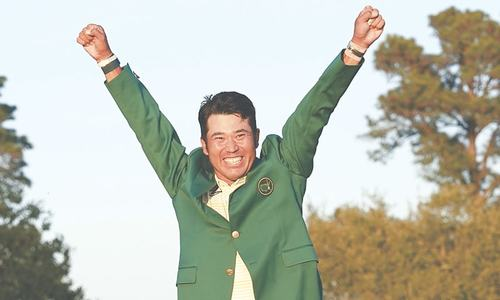 Japan's Matsuyama hangs on to make history at Masters