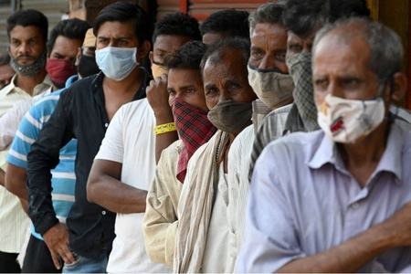 WHO warns pandemic at 'critical point' as cases surge in South Asia