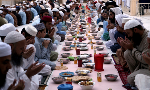 In pictures: Muslims in Pakistan and around the world mark a second Ramazan under Covid-19's shadow