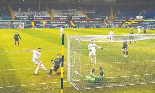 Spurs' top-four bid fades further with loss at Leeds