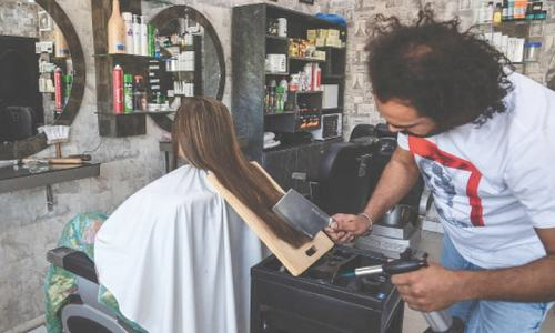 With cleavers & blowtorches, barber offers hair-raising cuts