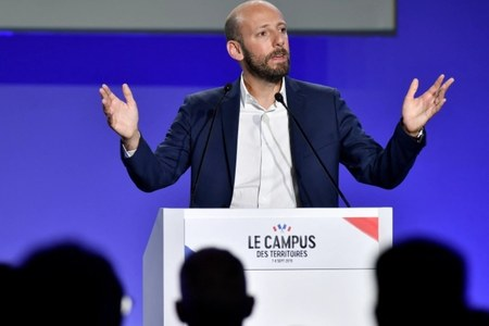 Head of Macron's party slams Muslim candidate's headscarf