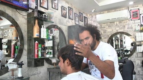 Lahore barber offers hair-raising cuts with cleavers and blowtorches