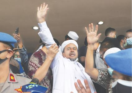 Indonesia court gives hardline cleric jail term for flouting Covid-19 curbs