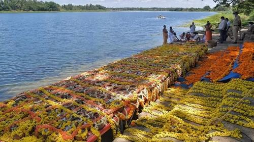 India submerges unclaimed ashes of 1,200 Covid dead in farewell ritual