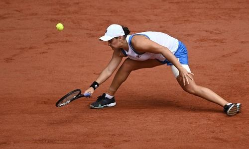 Barty limps out of French Open as Djokovic cruises through