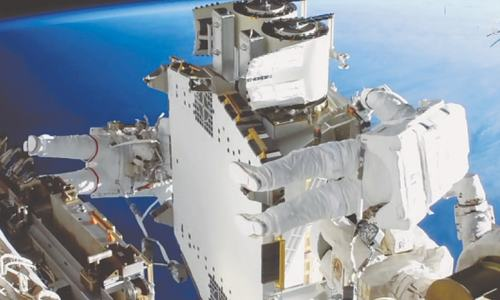 Astronauts install new solar panels on space station