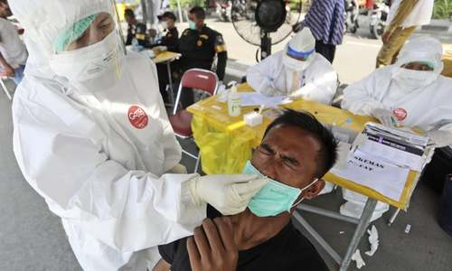 Indonesia hits 2m cases as Covid spirals out of control