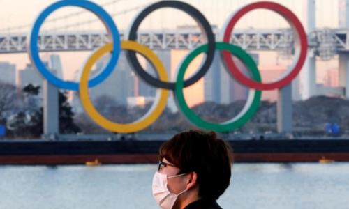 Tokyo organisers warn of no-fan Olympics as virus cases rise