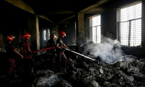 Bangladesh factory owner held after fire kills 52