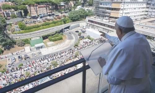 Pope greets followers from Rome hospital's balcony