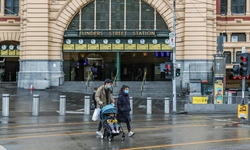 Melbourne joins Sydney in lockdown as Covid-19 spreads in Australia