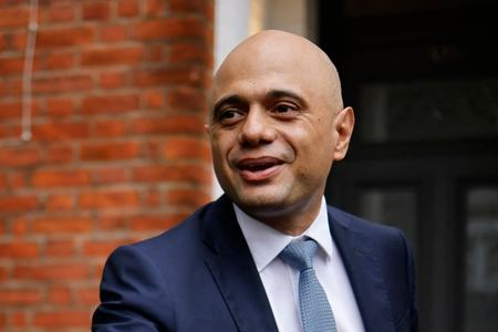 UK minister apologises for 'cower' Covid remark