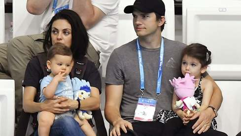 Ashton Kutcher and Mila Kunis don't believe in bathing themselves or their kids too often