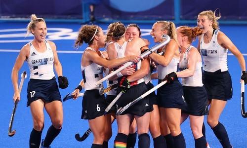 Britain win shootout to reach semis