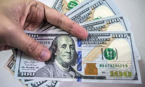Dollar hits 10-month high against rupee
