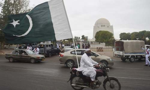 In pictures: Decked out in green and white, Pakistanis celebrate second Independence Day under Covid's shadow