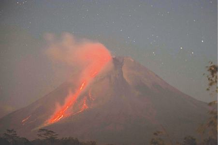 Lava streams from Indonesian volcano in new eruption